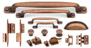 copper knobs and pulls. crafted from solid brass, the cliffside industries artisan cabinet hardware suite in old copper finish incorporates four pull sizes, three knobs, knobs and pulls e