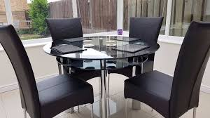 harvey s boat fixed round dining table in black glass with 4 faux leather chairs
