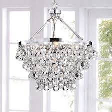 glamour adding crystals to a chandelier