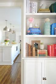 white built in bookshelves with kitchen in background