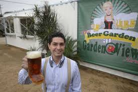 jorge hernandez owner of the beer garden at garden view stands by a kitchen