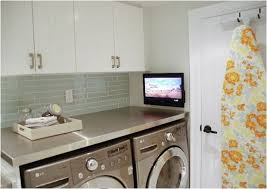 Love the idea of adding a clean-looking backsplash to the laundry room. via  Rambling Renovators: Laundry Room Reveal Pt 1