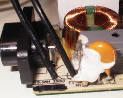 how to replace the power supply or fix a burnt fuse holder to the psu circuit board by sticking the ends of the wire through the holes where the old fuse used to attach the finished assembly should look