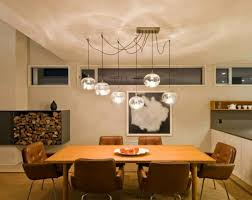 elegant contemporary dining room with round multiple glass pendant lighting over dining table with mid