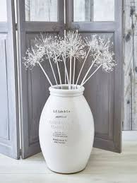 whitewashed ceramic floor vase with white branches