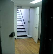 locations open safe room door with stairwell leading up to house