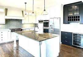 white kitchen cabinets with grey granite countertops