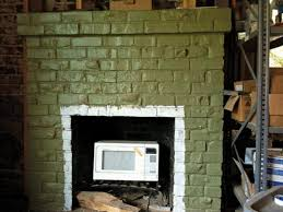 with multiple layers of paint a clinker brick fireplace in a 1905 house was