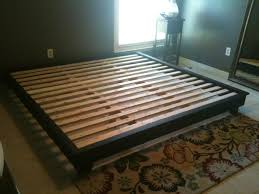 King platform bed plans Except I would make the drawers a little shorter  cut a perfect sized hole on the right DIY Network provides detailed  instructions