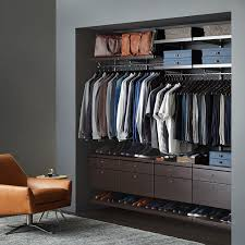 walnut elfa décor closet with drawer fronts
