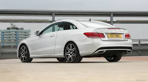 The overall shape remains untouched, but the headlamps and the taillamps—as well as the front and rear fascias—have been updated. Mercedes E Class Coupe 2014 Design Corral