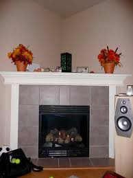 grey tile faced electric corner fireplace