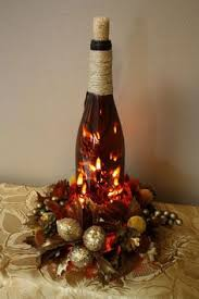 How To Decorate A Wine Bottle For Christmas This one is a wine bottle wrapped in yarn with some christmas 57