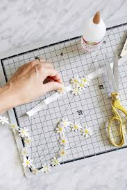 use a flowered trim like that daisy trim and cut each flower apart to make a quick appliqué pattern attach 3 4 flowers together in a cer a few inches