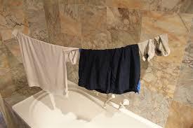 wash clothes in hotel bathtub ideas