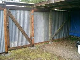 how to build a corrugated metal fence recycled corrugated metal fence and gate build corrugated metal fence