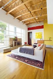 Decorating with primary colors family room modern with decorative pillows  wood flooring high ceiling