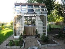 way to use old garage door now d greenhouse from old doors and windows