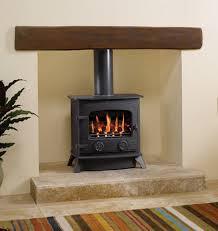 cast iron wood burner in modern cream fireplace