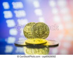 Physical Metal Bitcoin Coins With Trading Exchange Chart In The Background