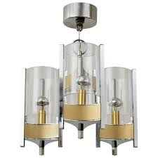 sciolari brushed brass and chrome hurricane glass chandelier for