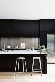 Kitchen With Bold Black Cabinets And Stainless Steel Backsplash Inspiration Stainless Steel Table With Backsplash Minimalist