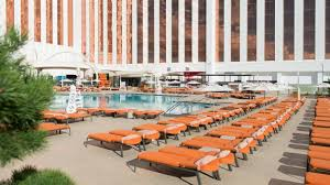 lounge chairs by the pool with grand sierra resort backdrop