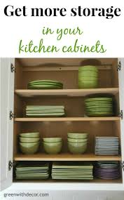 add extra storage in the kitchen cabinets with this easy trick