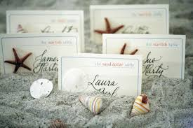 ocean themed wedding in southern florida inside weddings Beach Themed Wedding Place Cards escort cards in sand decorated with seashells beach themed place cards for wedding