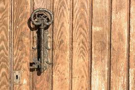 the old door handle in the form of keyin the spanish coastal town stock photo colourbox