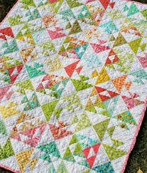 8 Sweet Baby Girl Quilt Patterns That'll Make You Swoon & pieced fish quilt featuring flying geese design Adamdwight.com