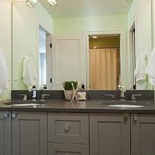 metropolitan cabinets and countertops gray kids bathroom vanity with green nautical cage sconces