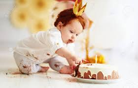 Curious Baby Boy Poking Finger In His First Birthday Cake Stock