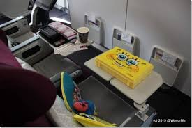 The bulkhead row will be the big winner assuming you can score those seats  Plenty of legroom though it is also a bassinet location so that might get  in
