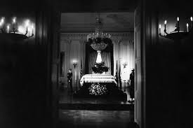 fact file unusual facts about jfk s assassination fact check  the flag draped casket of jfk lies in state in the east room of the