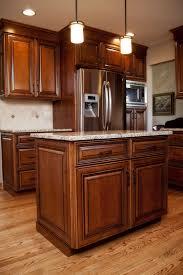 maple kitchen cabinets with black appliances. Beautiful Maple Stained Cabinets With Black Glaze In This Plainfield, IL Cook\u0027s Kitchen. Kitchen Appliances F