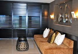 ... Stylish shutters create a beautiful wall draped in modern charm