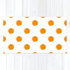 orange and white rug polka dots on blue