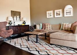 accent wall living room contemporary with earth tone colors dark floor