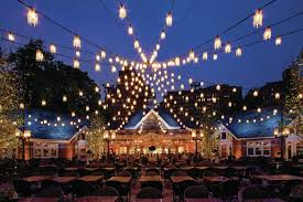 the new courtyard lighting a series of miniature chandeliers strung to mimic the silhouette of