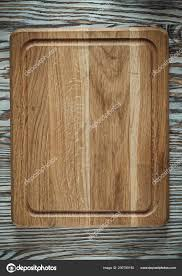 chopping board on vintage wooden surface stock image