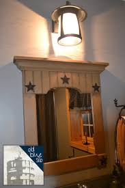 primitive bathroom lighting. i actually chose an outdoor light with a black finish from lowes and this accent mirror in painted mustard color country primitive store bathroom lighting