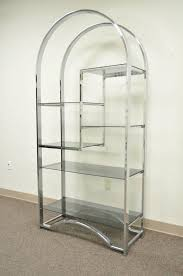striking arched chrome vintage etagere or bookcase in the style of milo baughman in addition