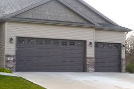 brown garage doors with windows. Brown Garage Doors In Tan Siding And Brick With Windows N