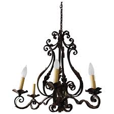 french iron chandelier with acanthus leaves for