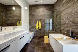 at seven bathrooms that fall around the 100 square foot mark some smaller some bigger and see how layouts materials style and most important