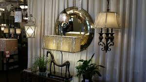 this display features uttermost capital lighting and kichler