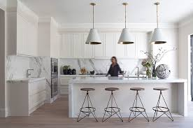 this updated take on the hamptons kitchen is designed by green couch in san fransisco handless cabinetry gives the space a contemporary edge