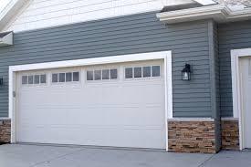 almond garage doormadisonwindowinsertsinalmondcarriagestylegaragedoorsin