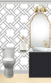 black white and gold powder room with black vanity and marble top vessel sink